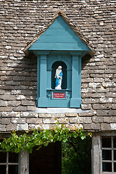The Sancta Maria Byre with a shrine to the Virgin Mary mounted on the gable at Snowshill Manor