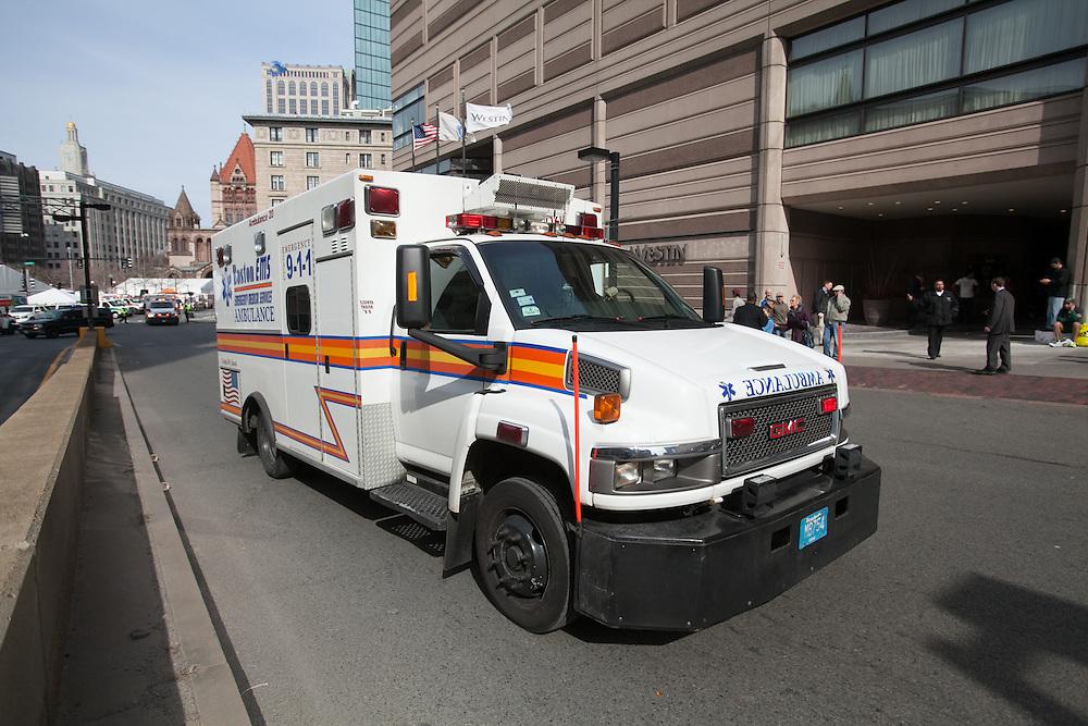 Boston, MA 04/15/2013.A Boston EMS ambulance departs Copley Plaza after two explosions at the end of the Boston Marathon on Monday..Alex Jones / www.alexjonesphoto.com