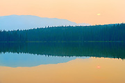 Sun setting over the Rocky Mountains with heavy fire smoke in the air<br /> Nordegg<br /> Alberta<br /> Canada