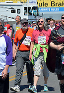 Two walkers cross the finish line.