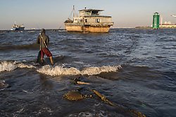 August 27, 2017 - Jakarta, Indonesia - A man fishing on the rising sea level in the north Jakarta, Indonesia, on August 27, 2017. In fifty years' time, the sea level in Jakarta expected to be 3 to 5m above street level. (Credit Image: © Anton Raharjo/NurPhoto via ZUMA Press)