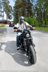 Putte Gustafsson riding his Harley-Davidson on a Twin Club ride out from the club house in Norrtälje after their annual Custom Bike Show. Sweden. Sunday, June 2, 2019. Photography ©2019 Michael Lichter.