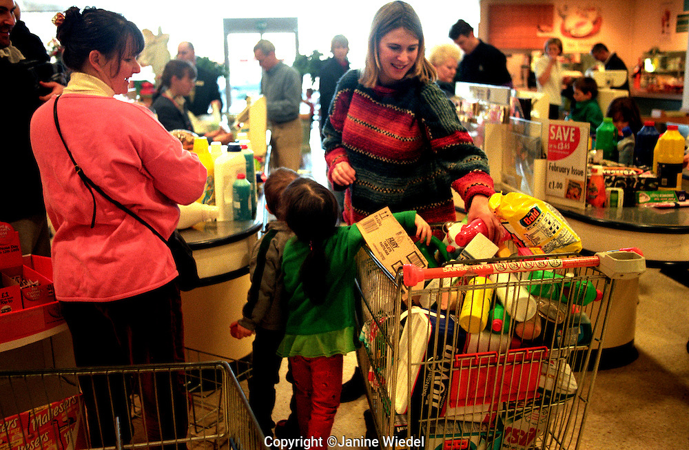 Weekly family shopping trip to a  supermarket.