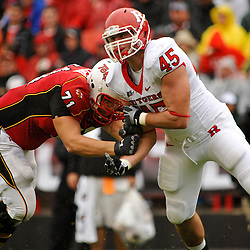 Sep 26, 2009; College Park, MD, USA; Rutgers defensive end Alex Silvestro (45) battles Maryland offensive lineman Paul Pinegar (71) during the first half of Rutgers' 34-13 victory over Maryland in NCAA college football at Byrd Stadium.