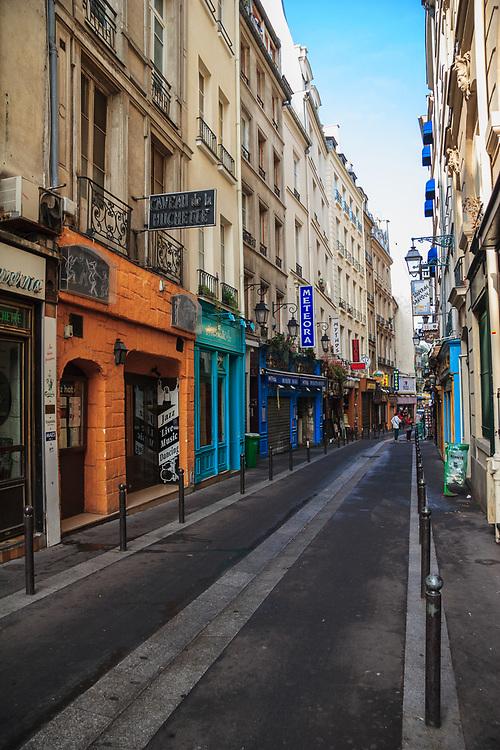 The rue de la Huchette in Paris, France. The rue de la Huchette is one of Paris' oldest Rive Gauche streets. The Caveau de la Huchette is famous jazz and a be-bop club.