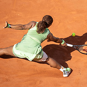 PARIS, FRANCE June 6. Serena Williams of the United States does the splits as she slips of the clay court while reaching for a shot during her loss against Elena Rybakina of Kazakhstan on Court Philippe-Chatrier during the fourth round of the singles competition at the 2021 French Open Tennis Tournament at Roland Garros on June 6th 2021 in Paris, France. (Photo by Tim Clayton/Corbis via Getty Images)
