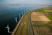 Nederland, Flevoland, IJsselmeerdijk, 08-09-2009. Windmolens, onderdeel van het windmolenpark (of windpark) van NUON in het water van het IJsselmeer, omgeving van de Flevocentrale gezien naar de Noordoostpolder. Rechts autosnelweg de A6, links het water van het IJsselmeer met samenklonterende  blauwalgen. De algenbloei is het resultaat van eutrofiering (ten gevolge van de aanvoer van meststoffen uit de landbouw).Windmills, part of the wind farm (or wind park) of NUON in the water of the IJsselmeer, near the Flevocentrale seen to the Noordoostpolder. Right the A6 motorway, left the water of the IJsselmeer with blue algae. The algae bloom is the result of eutrophication(caused by fertilizers coming from the agriculture).(toeslag); aerial photo (additional fee required); .foto Siebe Swart / photo Siebe Swart