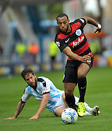 Jacob Butterfield of Huddersfield Town is beaten by Matt Phillips of Queens Park Rangers during the Sky Bet Championship match at the John Smiths Stadium, Huddersfield<br /> Picture by Graham Crowther/Focus Images Ltd +44 7763 140036<br /> 29/08/2015