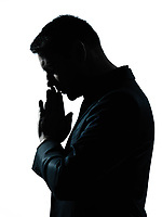 one caucasian business man thinking praying  portrait silhouette in studio isolated on white background