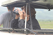 Africa, Tanzania, Lake Manyara National Park Safari tourists watching the wildlife from a landrover