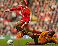 Photo. Jed Wee.<br /> Liverpool v Wolverhampton Wanderers, FA Barclaycard Premiership, Anfield, Liverpool. 20/03/2004.<br /> Liverpool's Steven Gerrard (L) leaps over a sliding challenge from Wolves' Shaun Newton.