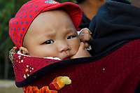 Baby looking into the camera at Tongbiguan, Dehong, Yunnan, China