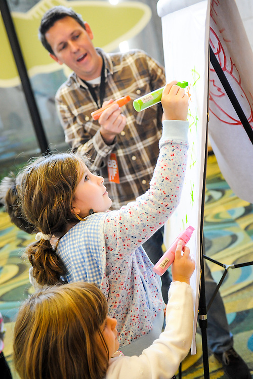 Children's author Bob Shea leads kids in a drawing lesson at the Boston Book Festival in the Boston Public Library.