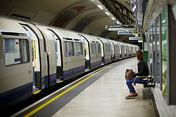 © Licensed to London News Pictures. 23/05/2016. London, UK. Commuters wait for a Piccadilly line train at Finsbury Park Underground station in London on 23 May 2016. The long-awaited 24-hour weekend service is officially announced to begin on 19 August 2016 on the Central and Victoria lines, with the Piccadilly, Jubilee and Northern to follow in the autumn. Photo credit: Tolga Akmen/LNP