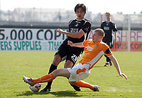 Photo: Paul Thomas.<br /> Blackpool v Swansea City. Coca Cola League 1. 15/04/2006.<br /> <br /> Swansea's Rory Fallon is tackled by Blackpool's Kieth Southern.