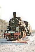 Steam Locomotive on display outside Komsomolsk-na-Amure railway workshops.Komsomolsk-na-Amure, Siberia, Russia