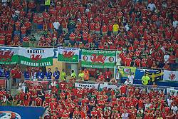 "LYON, FRANCE - Wednesday, July 6, 2016: Wales supporters with banners ""Buckley Wrexham loyal"" ""Cardiff City pride of Wales"" and ""Feyenoord Rotterdam stronger through struggle"" during the UEFA Euro 2016 Championship Semi-Final match against Portugal at the Stade de Lyon. (Pic by Paul Greenwood/Propaganda)"