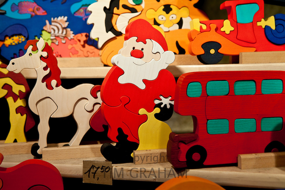Father Christmas and other wooden puzzles  at Christmas market, Winter Wonderland, in Hyde Park, London