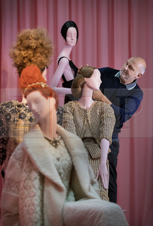 © Licensed to London News Pictures. 01/11/2016. London, UK. Hair stylist Sam McKnight puts the finishing touches to a display of mannequins highlighting his work for Chanel at the 'Hair by Sam McKnight' exhibition at Somerset House. The show, which runs from 2nd November, 2016 to 12th March, 2017, celebrates the career of fashion's favourite hair stylist. Photo credit: Peter Macdiarmid/LNP