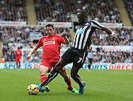 Joe Allen of Liverpool fouls Moussa Sissoko of Newcastle United in the penalty box - Barclays Premier League - Newcastle Utd vs Liverpool - St James' Park Stadium - Newcastle Upon Tyne - England - 1st November 2014  - Picture Simon Bellis/Sportimage