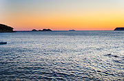 Sunset over the sea. Uvala Sumartin bay between Babin Kuk and Lapad peninsulas. Dubrovnik, new city. Dalmatian Coast, Croatia, Europe.