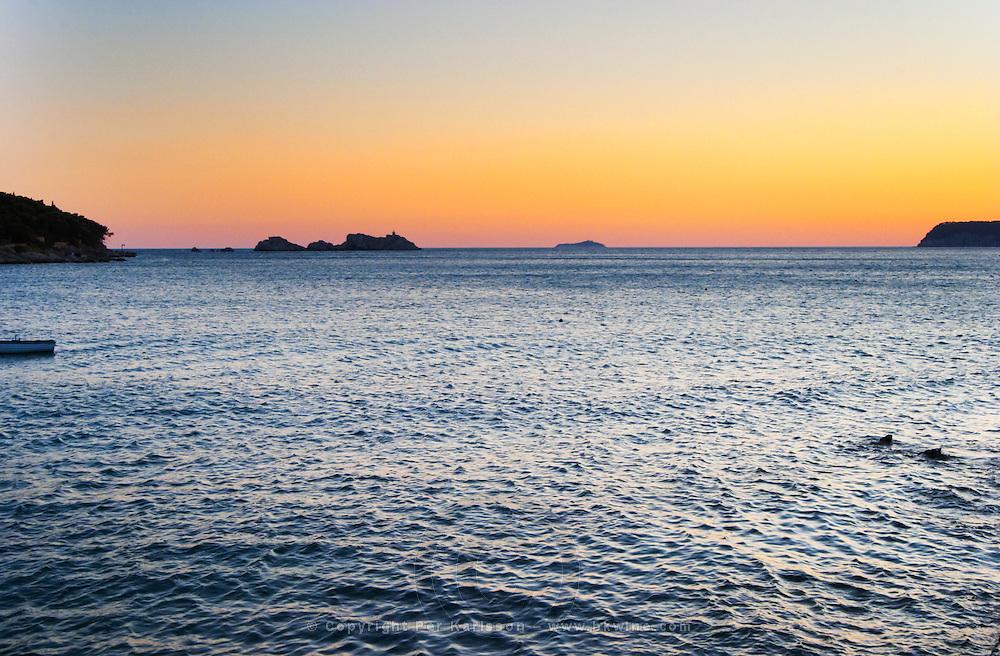 Sunset over the sea. Uvala Sumartin bay between Babin Kuk and Lapad peninsulas. Dubrovnik, new city. Dalmatian Coast, Croatia, Europe.