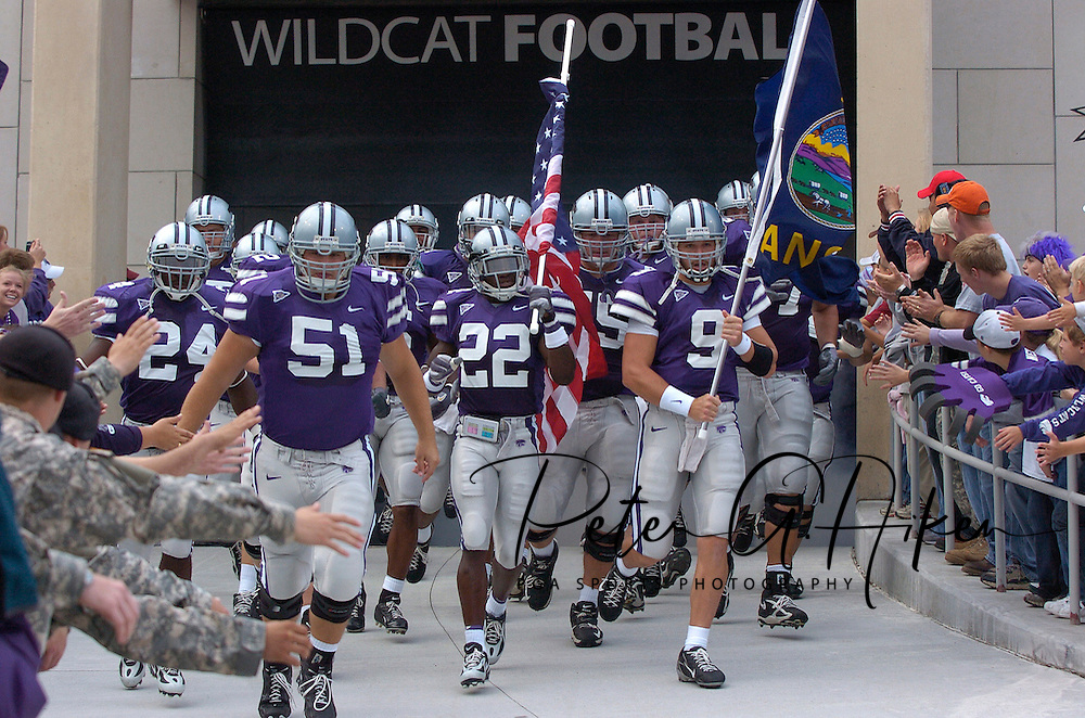 The Kansas State Wildcats run down the ramp lead by Justin McKinney (22) and Dylan Meier (9) before the Wildcats game with Florida Atlantic at Bill Snyder Family Stadium in Manhattan, Kansas, September 9, 2006.  The Wildcats beat the Owls 45-0.