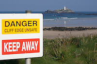 Danger, warning signs along the cliff edges at Godrevy, Cornwall, UK