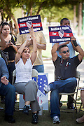 """June 13 - PHOENIX, AZ: People at an immigrants' rights rally and vigil at the Arizona State Capitol in Phoenix Sunday. About 40 immigrants' rights activists from Anaheim, California, joined Phoenix area activists at the Arizona State Capitol Sunday for a prayer vigil and rally against SB 1070, the Arizona law that gives local law enforcement agencies the power to ask to see proof of immigration status in the course of a """"lawful contact"""" and when """"practicable."""" Immigrants' rights and civil rights activist say the bill will lead to racial profile. Proponents of the bill say it is the toughest local anti-immigration bill in the country and merely brings state law into line with federal immigration law.  The law, which was signed by the Arizona Governor in April, goes into effect on July 29, 2010.   Photo by Jack Kurtz"""
