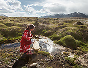 Six-year old Susaï is fetching water near camp in a spring claimed as one of the sources of the Oxus, also known as Amu Darya, Central Asia's largest river.  Its waters define most of Afghanistan's borders with other nations to the north.<br /> Summer camp of Muqur, Er Ali Boi's place.<br /> <br /> Trekking through the high altitude plateau of the Little Pamir mountains (average 4200 meters) , where the Afghan Kyrgyz community live all year, on the borders of China, Tajikistan and Pakistan.