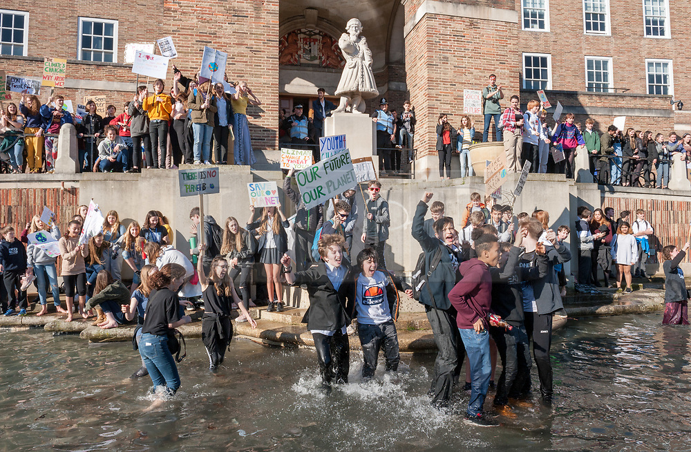 © Licensed to London News Pictures. 15/02/2019. Bristol, UK. Youth Strike 4 Climate outside Bristol City Hall on College Green. Young people waded into the moat outside City Hall. The Bristol event is part of the first UK Youth Strike 4 Climate nationwide day of protest as students and school pupils across the UK miss classes, striking to protest a lack of government action to combat the climate crisis. The international movement was started by Swedish student Greta Thunberg. Photo credit: Simon Chapman/LNP