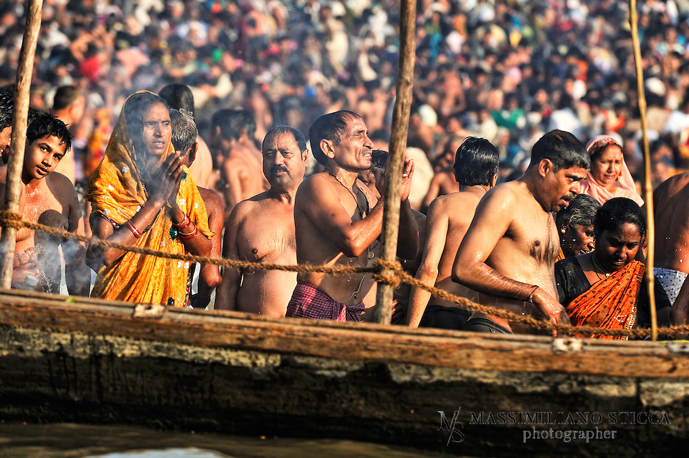 Hindu devotees pray after a holy dip at Sangam, the confluence of Hindu holy rivers Ganges, Yamuna and the mythical Saraswati.