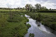 Stream running through the British countryside near Studley, England, United Kingdom.