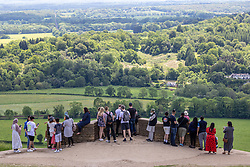 Licensed to London News Pictures. 05/06/2021. Dorking, UK. After the heavy rains yesterday Members of the Public enjoy the warm sunshine on Box Hill in Surrey as the fine June weather continues. The Met Office have forecast very warm weather for the South East and London with temperatures predicted to hit up to 24c this week. Photo credit: Alex Lentati/LNP