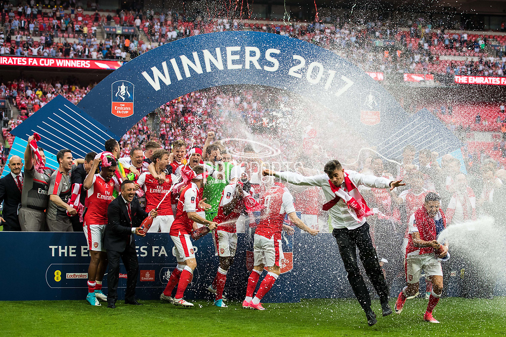 Arsenal players Arsenal defender Per Mertesacker (4), Arsenal forward Danny Welbeck (23), Arsenal goalkeeper Petr Cech (33), Arsenal forward Alexis Sanchez (7) celebrate winning the  The FA Cup Final match between Arsenal and Chelsea at Wembley Stadium, London, England on 27 May 2017. Photo by Sebastian Frej.