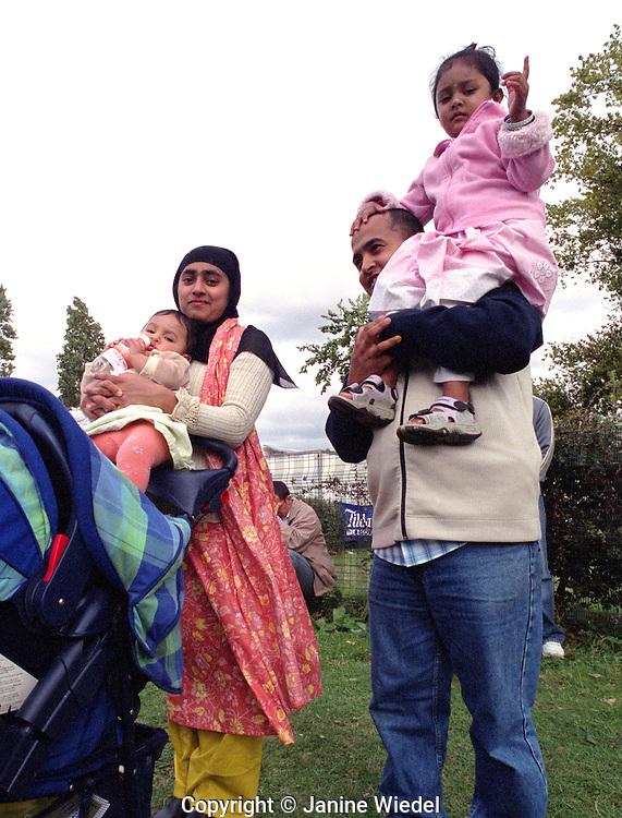 Bangladeshi family celebrating at summer festival near Brick Lane in east London.