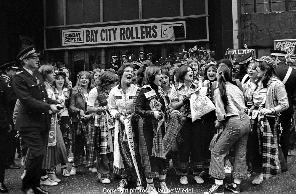 Young Bay City Roller fans & groupies outside venue where Bay City Rollers were playing London 1976
