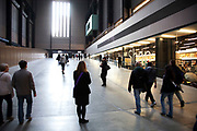 People come and go in the Turbine Hall at Tate Modern museum for Modern Art on the Southbank of London. This has become London's centre for Contemporary arts.