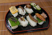 """A selection of insect sushi. From front left to back right: sakura moth caterpillar; joro spider; privet-hawk moth larva; Madagascar cockroach; Asian hornet larvae; dobson fly larva; Japanese cicada; green tree ant larvae.Tokyo resident Shoichi Uchiyama is the author of """"Fun Insect Cooking"""". His blog on the topic gets 400 hits a day. He believes insects could one day be the solution to food shortages, and that rearing bugs at home could dispel food safety worries."""