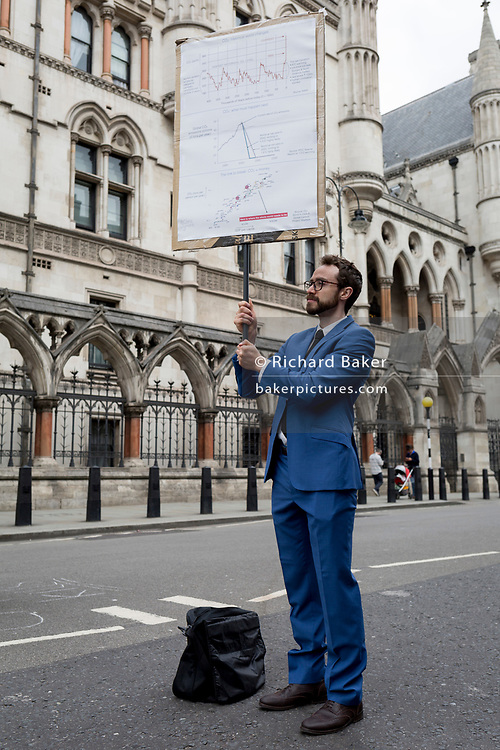 """Environmental and climate change protesters block Fleet Street on the first day of a week-long country-wide protests using using five boats to stop traffic in Cardiff, Glasgow, Bristol, Leeds, and London, on 15th July 2019, in London, England. The group is calling on the government to declare a climate emergency, saying it was beginning a five-day """"summer uprising"""" and that 'Ecocide' ought to be a criminal offence in law."""