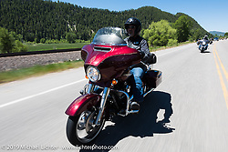 Eric Martinez ofHighlands Ranch, CO and member of the Douglas County HOG Chapter on his Street Glideriding the 20 Mile Road in Steamboat Springs during the Rocky Mountain Regional HOG Rally, Colorado, USA. Saturday June 10, 2017. Photography ©2017 Michael Lichter.