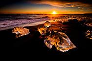Sun's rays breathe life into the ice blocks and awaken their soul on the Black Sand Beach, Jökulsárlón, Iceland.