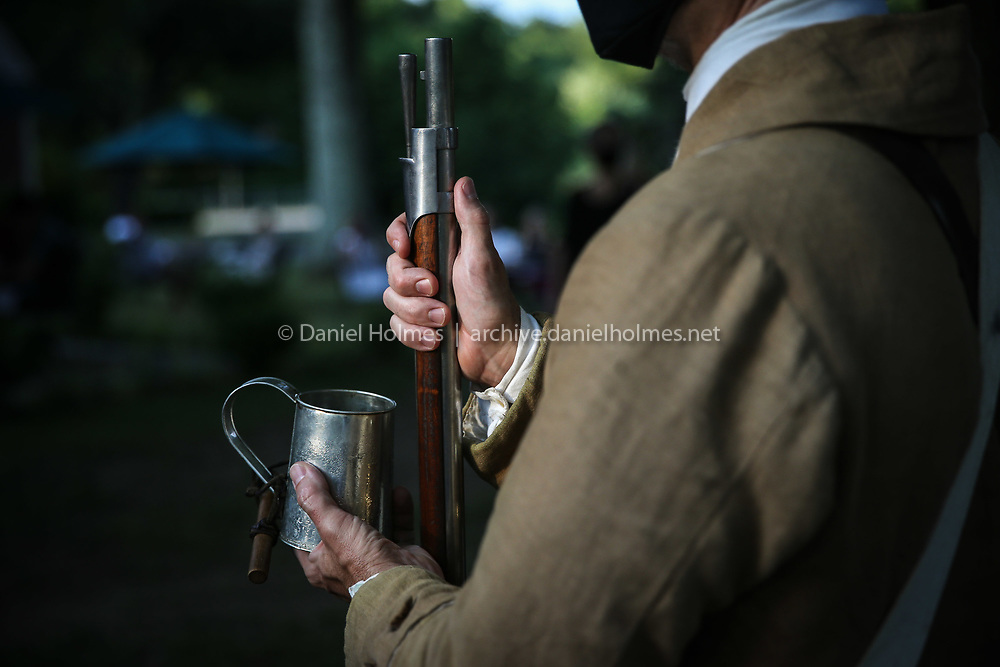Musket and water at the ready during the public reading of the Declaration of Independence at the Wayside Inn in Sudbury, on Jul. 2, 2020. [Daily News and Wicked Local Photo/Dan Holmes]