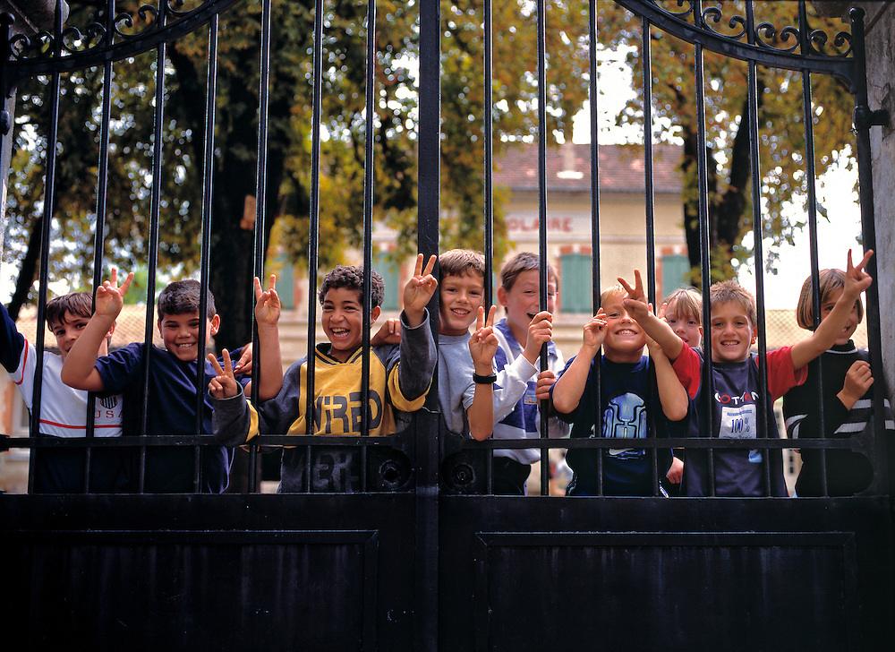 Friendly school children greet visitors in the village of Cereste in Provence, France.