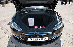 © Licensed to London News Pictures. 06/06/2015. Bristol, UK.  A Tesla car which has two boots, one at the back and one at the front because the motors are on the back wheels, at a display of electric, hybrid, and low emission vehicles at Bristol's Millennium Square sponsored by EDF energy.  The cars are engineered to produce no or low emissions and pollution to reduce the impact of transport on the environment.  Photo credit : Simon Chapman/LNP