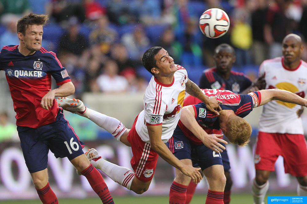 Tim Cahill, (centre), New York Red Bulls, challenges for a cross in the penalty area with Greg Cochrane, (left), and Jeff Larentowicz, Chicago Fire, during the New York Red Bulls Vs Chicago Fire, Major League Soccer regular season match at Red Bull Arena, Harrison, New Jersey. USA. 10th May 2014. Photo Tim Clayton