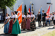The catholic holiday of Corpus Chisiti is a much celebrated tradition among the catholic Sorbian Minority. Dozens of Druschkas in traditional costume walk with Germans, Ministrants and residents of Wittichenau in groups through town, singing and praying. Two processions, one in the morning and one in the afternoon, follow devotions and prayers through the streets that are adorned with birch trees.<br /> <br /> Wittichenau, Saxony, May 31, 2018.