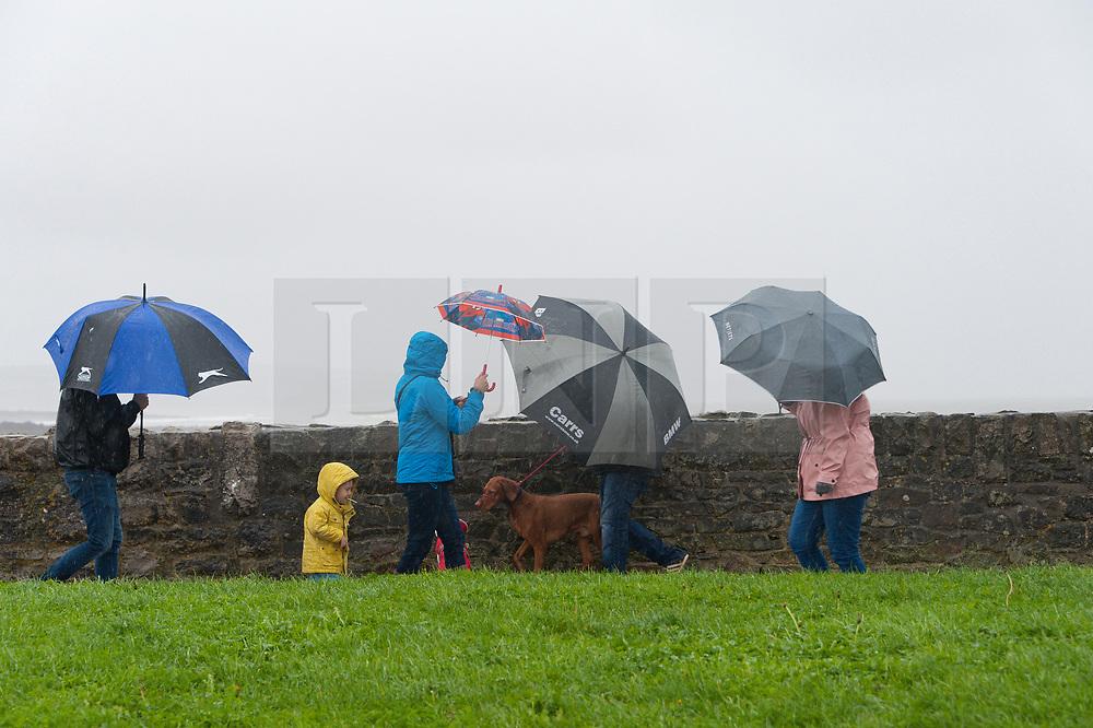 © Licensed to London News Pictures. 02/11/2019. Porthcawl, Bridgend, Wales, UK. Gale force winds and rain lash the seaside resort of Porthcawl in Bridgend, UK. Photo credit: Graham M. Lawrence/LNP