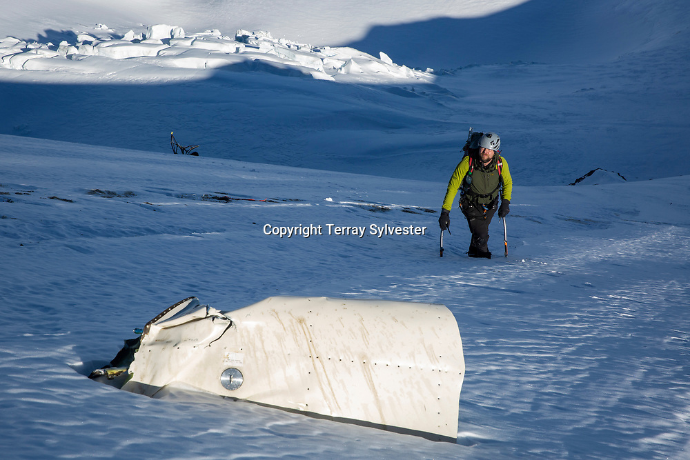 Randy Lee, 45, of Hood River, looks at airplane debris on Thursday, January 31, 2019, while ascending the Cooper Spur beneath the site of a plane crash on Mount Hood. The pilot, George Regis, 63, died in the crash while reportedly flying from his home in Battleground, Washington, to Arizona.