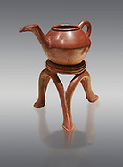 Terra cotta Hittite beaker shaped side spouted teapot and three legged stand - 1700 BC to 1500BC - Kültepe Kanesh - Museum of Anatolian Civilisations, Ankara, Turkey. Against a grey  background .<br /> <br /> If you prefer to buy from our ALAMY STOCK LIBRARY page at https://www.alamy.com/portfolio/paul-williams-funkystock/hittite-art-antiquities.html  - Type Kultepe  into the LOWER SEARCH WITHIN GALLERY box. Refine search by adding background colour, place, museum etc<br /> <br /> Visit our HITTITE PHOTO COLLECTIONS for more photos to download or buy as wall art prints https://funkystock.photoshelter.com/gallery-collection/The-Hittites-Art-Artefacts-Antiquities-Historic-Sites-Pictures-Images-of/C0000NUBSMhSc3Oo